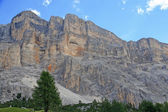 Rocky wall with orange nuances of the Dolomites in Italy — Stock Photo