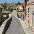 Stock Photo: Ancient Romaqueduct became sidewalk in town of Perugia