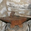 Old and rusted iron anvil for beating — Stock Photo