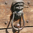 Iron door knockers with one face to knock — Stock Photo