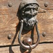 Iron door knockers with one face to knock — Stock Photo #12567215