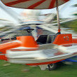 Motion of a toy airplane  of amusement park - Stock Photo