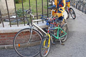 Bike for adult and for child attached by a padlock — Photo