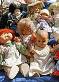 Collection of antique dolls items on sale market — Stock Photo