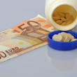 Fifty euro banknote with a bottle of expensive drugs — Stock Photo