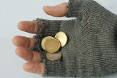 Hand into the glove of a poor beggar — Stock Photo