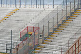 Empty concrete bleachers of the stadium before a football game — Stock Photo