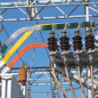 Постер, плакат: Copper bars and insulators of electricity transformers in a elec