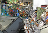 Electronic equipment and circuit boards disposed in waste landfi — Stock Photo