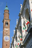 High tower of the basilica palladiana in vicenza and Italian fla — Stock Photo