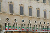 Medieval palace with Italian tricolor flags in vicenza in italy — Стоковое фото