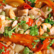 Prawn and shrimp with peppers in a rice with seafood - Foto Stock