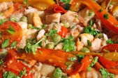 Prawn and shrimp with peppers in a rice with seafood — Stock Photo