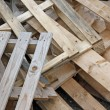 Pile of wooden pallets for transportation of material - Stock fotografie