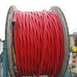 Reels with red cord coiled ready to be laid underground — Stock Photo #13672855