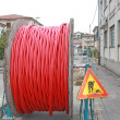 Roadworks and coil of wire with excavation — Stock Photo #13673041