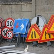 Road signs ready to be installed near road works — Stock Photo #13673336