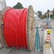 Stock Photo: Spool of cable and fiber optics in road during outdoor a