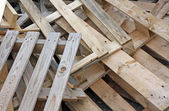 Pile of wooden pallets for transportation of material — Stock Photo