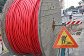 Roadworks and a coil of wire with the road sign — Stock Photo