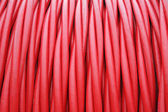 Storage of Red cord coiled around a Coil — Stock Photo