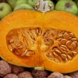 Sweet orange pumpkin cut in half with the seeds of pumpkin  — Stock Photo