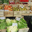 Fruit crates on sale vegetable market with vegetables — Stockfoto