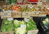 Fruit crates on sale vegetable market with vegetables — Stock Photo