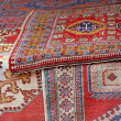 Stock Photo: Heaps of valuable oriental carpets and Afghcarpets for sale