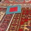 Blue carpet with red frame and other valuable oriental carpets — Stock Photo