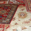 Carpets of various forms and various nationalities for sale at t — Stock Photo