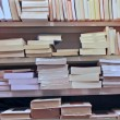 Stock Photo: Books stacked on top of each other in well stocked library