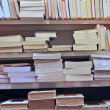 Books stacked on top of each other in a well stocked library — Stock Photo #13780292