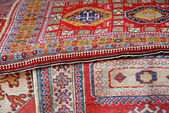 Collection of oriental carpets and precious Persians for sale — Stock Photo
