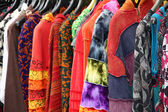 Ethnic clothes for women hanging on sale at the market — Stock Photo