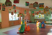 Living room full of games and slides of a nursery — Stock Photo