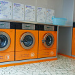 Automatic washing machines in a laundromat — Stock Photo #14210259