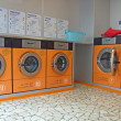 Automatic washing machines in a laundromat — Stock Photo #14210295