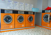 Automatic washing machines in a laundromat — Stock Photo