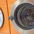 Automatic washing machines in a laundromat — ストック写真