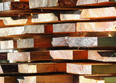 Wood cut and stacked in the Sun — Stock Photo
