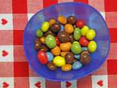 Tray full of chocolate candy covered with sugar — Stock Photo