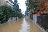 Narrow road flooded during a downpour in the city — Stock Photo
