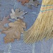 Straw broom to sweep the leaves of the garden — Stock Photo