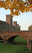 Red brick bridge of an ancient medieval castle — Stock Photo