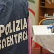 Italian scientific police  inside a crime scene — Stock Photo