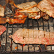 Juicy steaks cooked medium rare beef grilled on the barbecue - Stock Photo