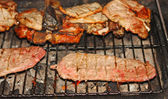 Juicy steaks cooked medium rare beef grilled on the barbecue — Stockfoto
