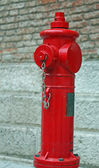 Red fire hydrant available of firefighters — Stock Photo