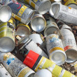 Empty spray cans used in an industry - Stock Photo